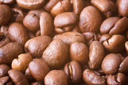 Roasted coffee beans, closeup. Background with blurred background. 写真素材