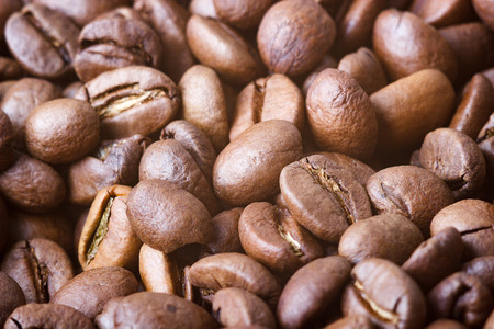 Roasted coffee beans, closeup. Background with blurred background.