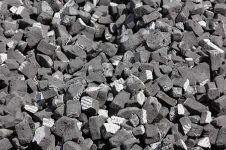 A scattering of gray slag on a sunny day 版權商用圖片