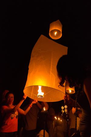 sky lantern: Tourist float sky lantern Editorial