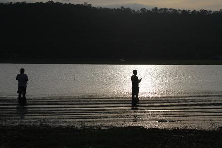 fly fishing: fishing before sunrise Stock Photo