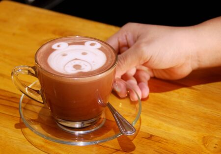serve: serve with hot chocolate and topping bear foam Stock Photo