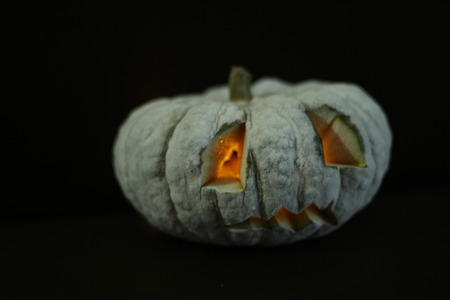 freeze: halloween pumpkin head in freeze  style black background close up Stock Photo