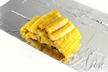 aluminium: sweet corn sliced on aluminium plate Stock Photo
