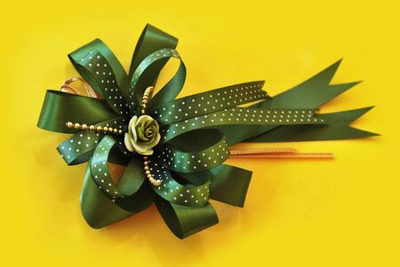 green bow: beautiful olive green bow on yellow background
