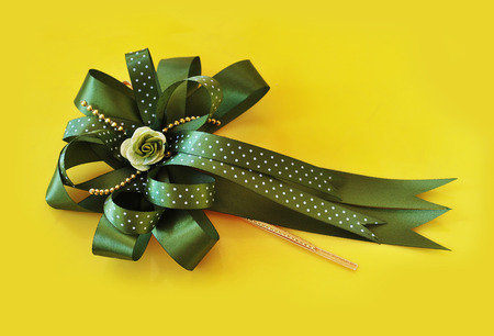 olive green: beautiful olive green bow on yellow background