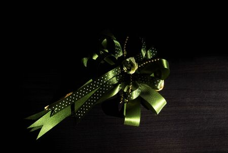olive green: beautiful olive green bow on wooden background