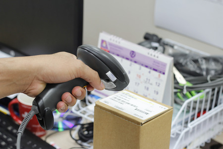 scaner: person hands with barcode scanner scanning on box