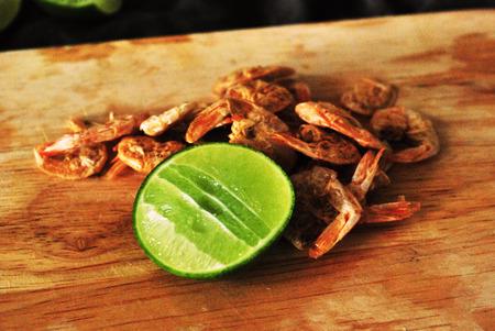 chop stick: lemon and dry shrimp on chop stick : used orange filter Stock Photo
