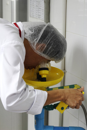 worker is using shower eyes wash