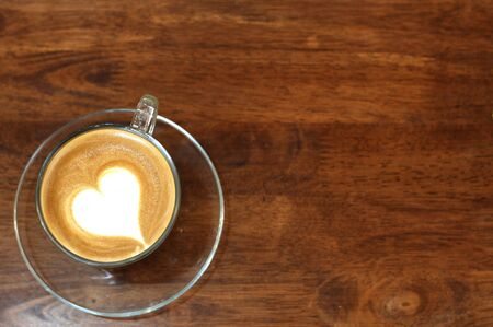 capuchino: hot coffee  on wooden table