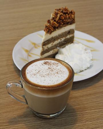 capuchino: hot capuchino with almond coffee cake background Stock Photo