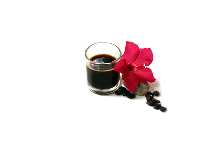 pinky: black coffee in shot glass with coffee bean and  pinky flower Stock Photo