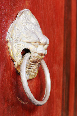 ancient lion: Chinese ancient door knocker Stock Photo