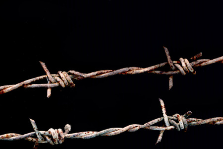 rusty barbed wire in black background Stock Photo