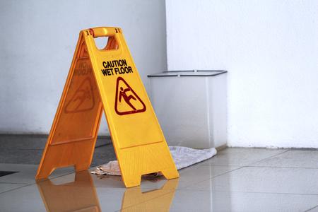 Sign showing warning of caution wet floor.Wet floor sign. Imagens
