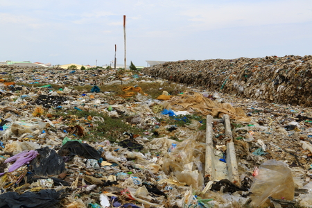 A huge pile of garbage mountain pond.