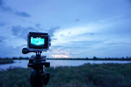 The camcorders have waterproof cases, setting the time to shoot the sky in the evening before it rains.