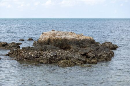 Brown rocks on the blue sea,  sea at noon 写真素材