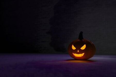 3D illustration, 3D rendering, The head of a scary demon pumpkin in an open room Stock fotó