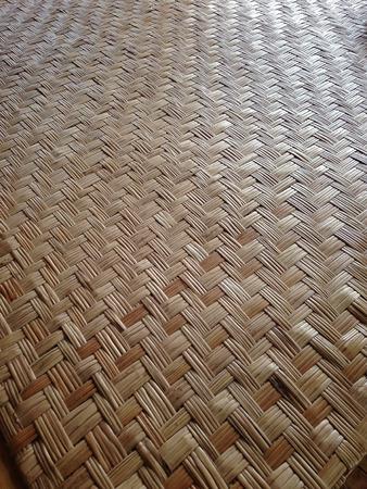 floor mat: Floor mat made from woven reeds Stock Photo