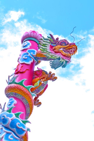 Dragon, Poles move towards a pan dragon sculpture sky  Symbol of faith that conveys power, fortune and faith  photo