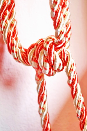 hands tied: Rope,Rope  Red and white silk rope