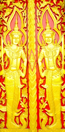 Patterns carved gold background red Buddhist church door  photo