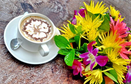 Fresh cup of coffee with flowers photo