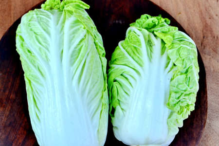 romaine: romaine lettuce standing on a wooden table