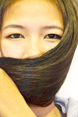 dark brown hair: woman long straight dark brown hair Stock Photo