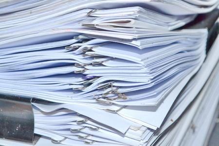 Pile of documents stack up high waiting to be managed  photo