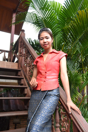 smiling young woman in traditional clothing from Laos photo