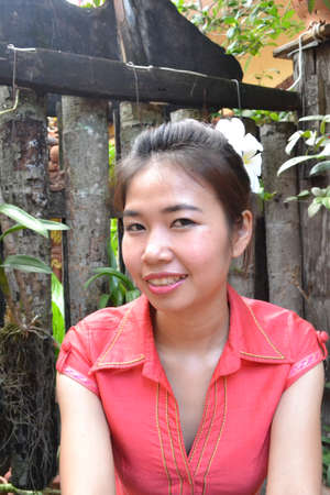 traditional clothing: Portrait of smiling young woman in traditional clothing from Laos
