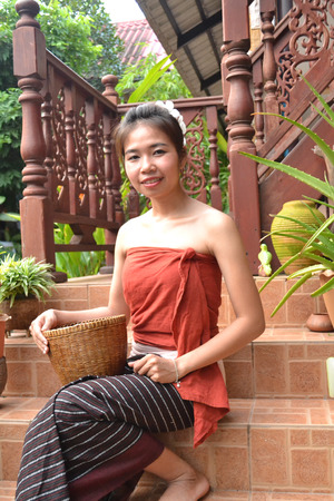 laotian: Portrait of smiling young woman in traditional clothing from Laos