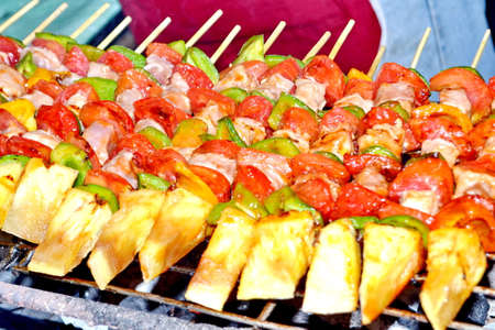 sizzling: Sizzling barbecue sticks with meat and vegetables