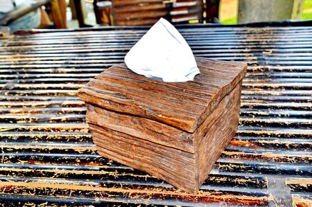 sniffles: Tissue paper box made by old wood.