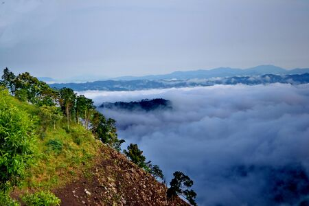 mountaintop: Clouds roll over the volcanic mountaintop during a rainy season
