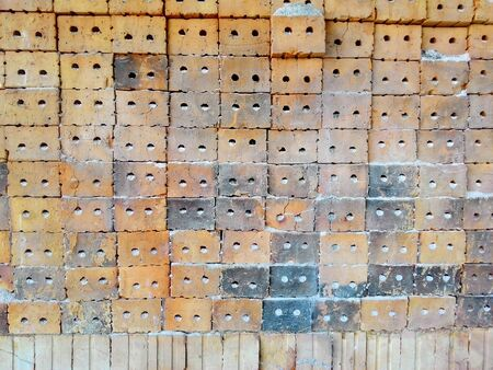 brick kiln: Stack of clay bricks texture background.