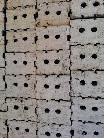 brick kiln: Stack of clay bricks texture background