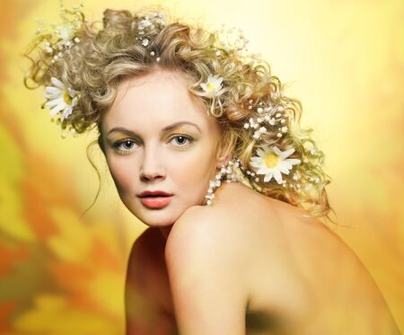 portrait of beautiful girl with flowers in their hair photo