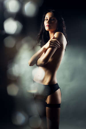 blurred lights: beautiful girl in black lingerie with a lower effect bokeh