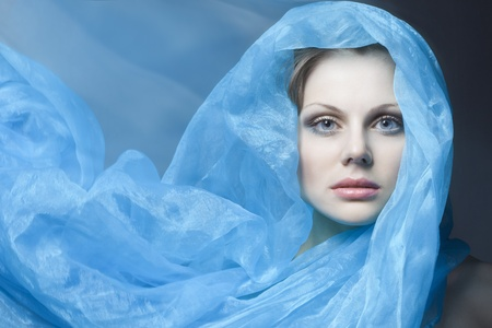 beautiful girl with blue cloth evolving Stock Photo