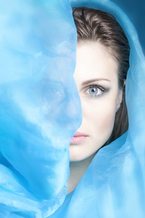 beautiful girl with blue cloth evolving Stockfoto