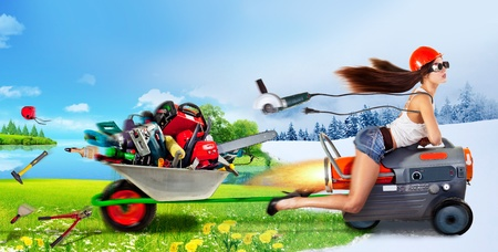 creative girl rides a heat gun and takes a trolley with different tools Stockfoto