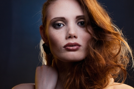 portrait of red-haired girl in a mixed light
