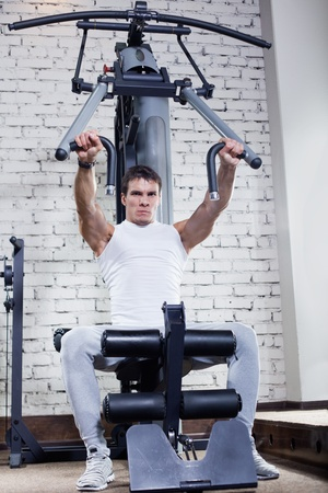 Fitness - powerful muscular man doing weightlifting in gym photo