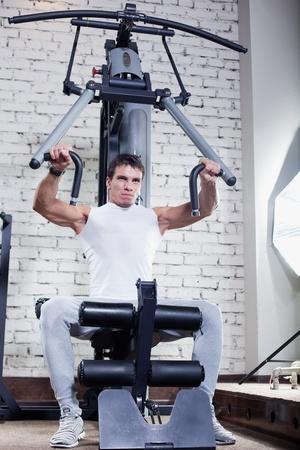 Fitness - powerful muscular man doing weightlifting in gym Stock Photo - 14715100