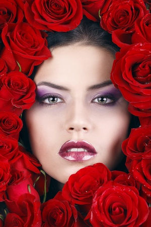 Portrait of young beautiful stylish girl with beautiful roses photo