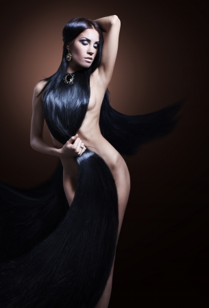 fashion sexy girl in a dress made of hair